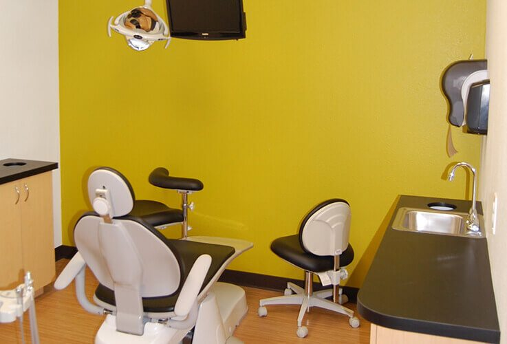 Clean comfortable dental chair and treatment room