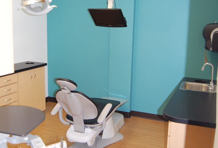 Blue treatment room and comfortable patient chair
