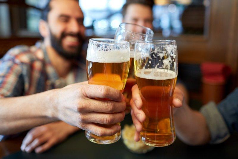Men drinking beer together