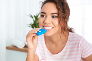 woman trying at-home teeth whitening