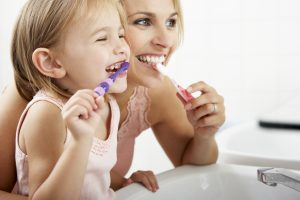 Family dentist in Wichita Falls places dental implant restorations.